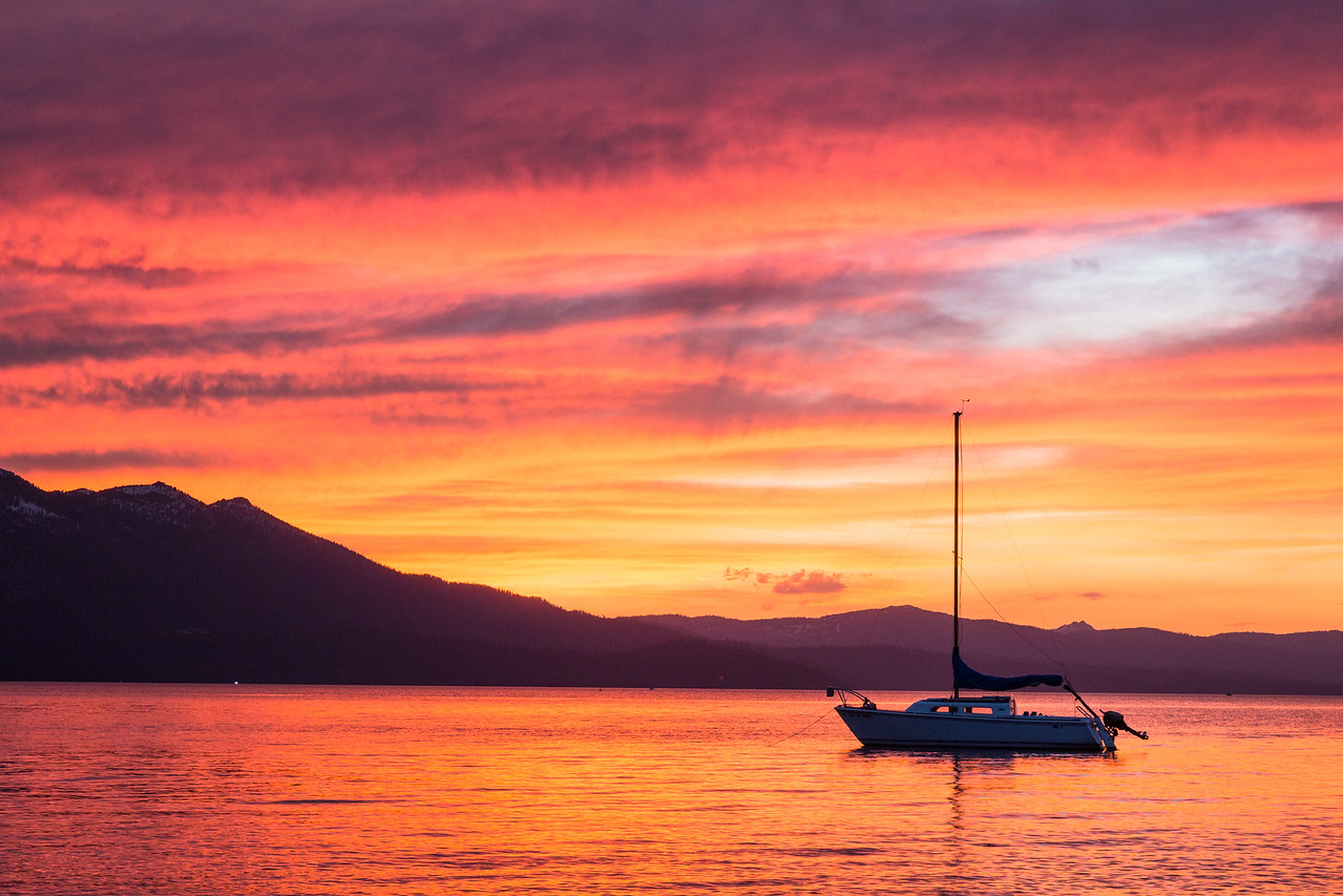 Lone Sailboat, Vibrant Sunset
