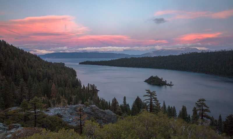 Vibrant Clouds Beyond a Windy Emerald Bay