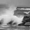 Waves Crashing Between Rocks