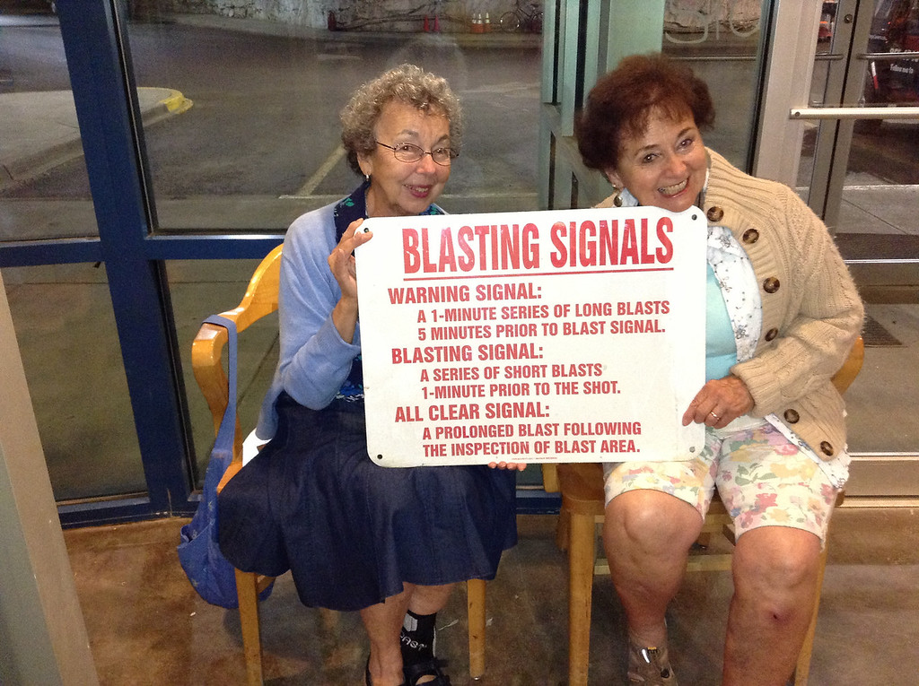 Mary Lacey (left) and Joan Tallman illustrating the dangers of cave exploring.