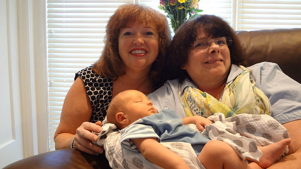 Grandmother Jodi Johnson [left] and Grandmother Donna Lacey with Cyrus