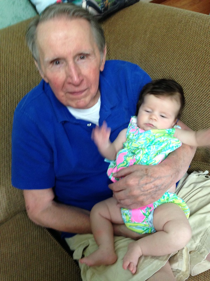 Great-Grandfather Jim holds Hilary for the first time.