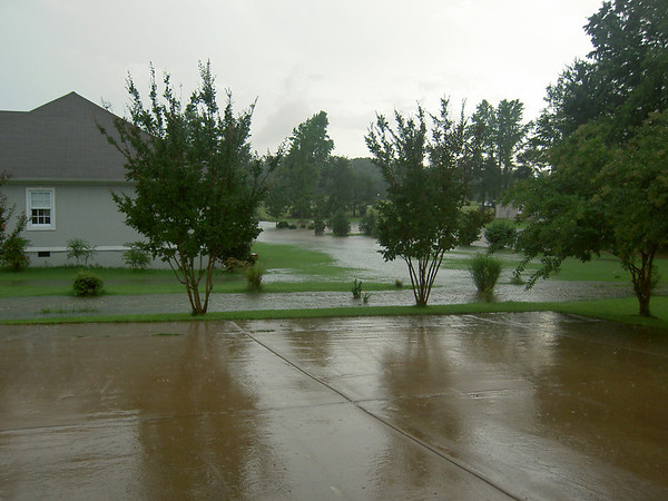 Spring Rains - sometimes a few inches in one storm. Good neighborhood drainage removes water quickly.