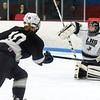 Longmeadow goalie Kayla Brown blockers aside an HPNA shot