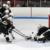 Taylor Markstein pops the puck over the HPNA goalie for a Longmeadow goal