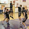 Longmeadow's Colin Lockhart (10) grabs the rebound at Friday's game against Westfield High.