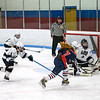 With Brookline's goalie pulled and Longmeadow shorthanded due to a penalty, goalie Kayla Brown preserves her shutout with the block on a Brookline shot