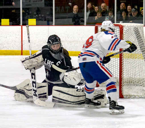 On a breakaway by Methuen forward Julia Masotta, Longmeadow goalie Kayla Brown snags the shot