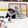 On a clean breakaway senior right wing Karalyn Jones fires a shot under the crossbar for a Longmeadow goal