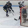 ... on the ensuing power play Jordan Kowalski makes the centering pass over the goalie's stick...