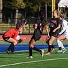 Goalie Adriana Arona (1) makes a save with the help of Bella Rinaldi (7) and Annie Boisseau (10)