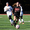 Emma Podolzky (13) leads the way as she maneuvers the ball.