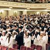 19 Graduates Stand at Seats