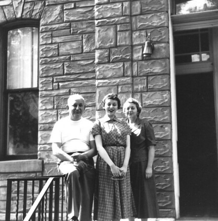 Mary with her parents Frank and Madeline Bonini on the front entrance to our Fifth Ave. apartment building