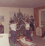 Decorating the Christmas tree was always  a big event in the Lacey home.