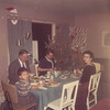 Sharing a Christmas family meal with Dr. and Mrs. Lacey. Jim IV is at the end of the table.