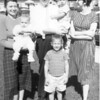 The Lacey children at 16 Willoughby Place, Ft Wayne IN. L>R, Joan (Lacey) Tallman with daughter Lisa, Jim Lacey III with Jim IV and holding Frank and Mary Lacey.