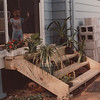 Jim III designed and built these steps to replace small and deteriorating concrete steps. The concrete blocks in the ground kept the steps from moving when the earth froze. Of course, they were improved with Mary's plants. That's Rory Lacey behind the screen door.