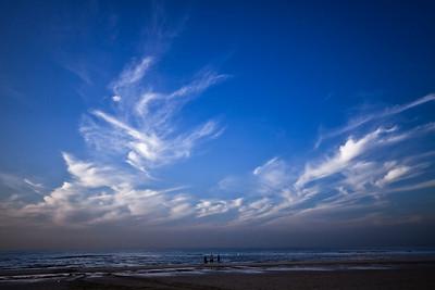 A beach with beautiful cloud formations near Alkmaar, the Netherlands.