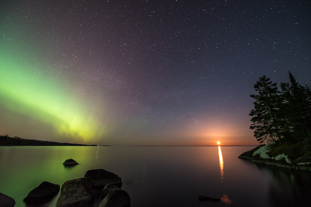 "AURORA 3544<br /> <br /> ""The Glory of Night""<br /> <br /> April 11, 2015 - The northern lights dance in the sky while the moon rises over Lake Superior.  You can see the faint ribbon of the Milky Way bridging the gap between the rising moon and the lights of the aurora."