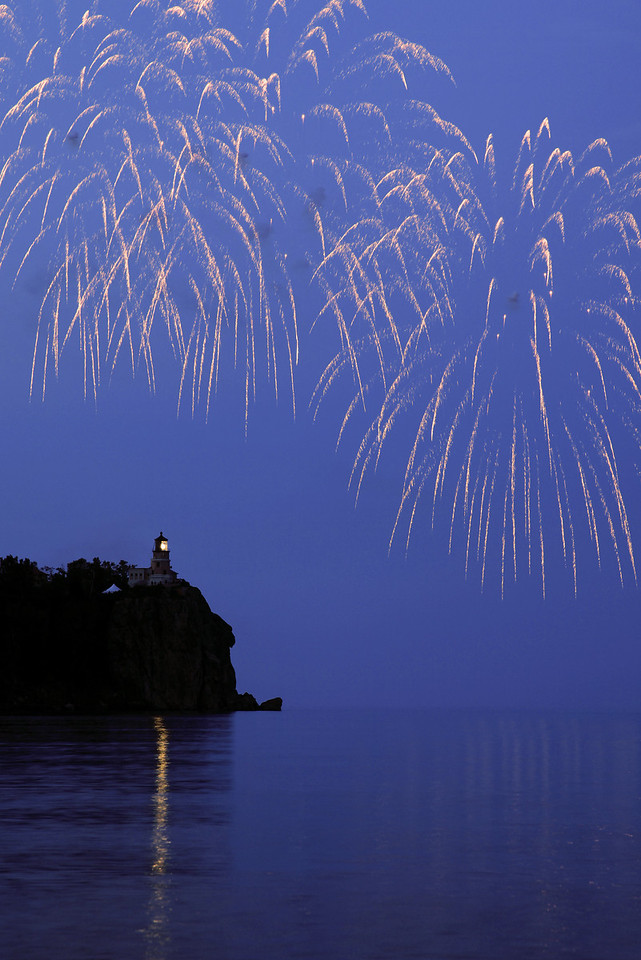 """FIREWORKS 8541<br /> <br /> """"Happy 100th Anniversary Split Rock!""""<br /> <br /> To celebrate the 100th anniversary of Split Rock Lighthouse, the light was lit and fireworks were launched over the lighthouse on the evening of July 31st, 2010.  Several hundred people were in attendance, including a LOT of photographers!  It was a special evening, and a rare treat indeed to see fireworks launched over the light."""