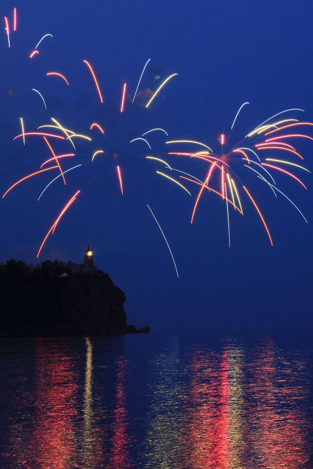 "FIREWORKS 8557<br /> <br /> ""Happy 100th Anniversary Split Rock!""<br /> <br /> To celebrate the 100th anniversary of Split Rock Lighthouse, the light was lit and fireworks were launched over the lighthouse on the evening of July 31st, 2010.  Several hundred people were in attendance, including a LOT of photographers!  It was a special evening, and a rare treat indeed to see fireworks launched over the light."