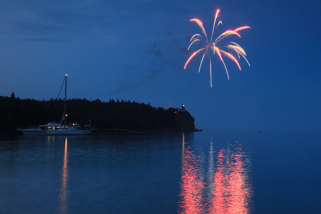 """FIREWORKS 8569<br /> <br /> """"Happy 100th Anniversary Split Rock!""""<br /> <br /> To celebrate the 100th anniversary of Split Rock Lighthouse, the light was lit and fireworks were launched over the lighthouse on the evening of July 31st, 2010.  Several hundred people were in attendance, including a LOT of photographers!  It was a special evening, and a rare treat indeed to see fireworks launched over the light."""