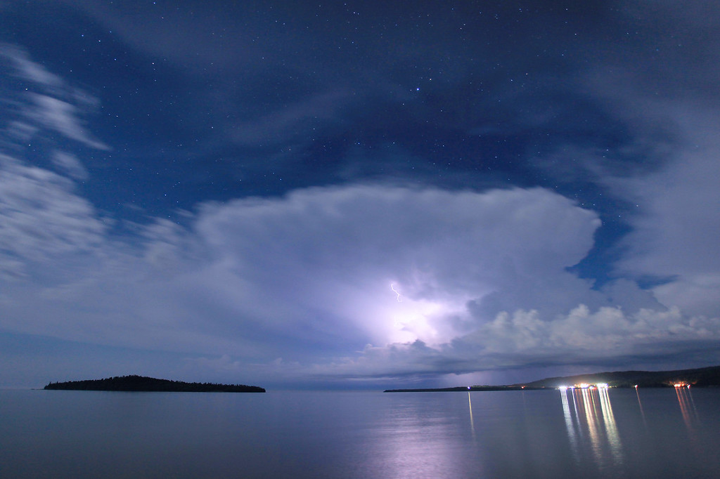 "LIGHTNING 1544<br /> <br /> ""August thunderstorm on a moonlit night over Grand Portage Bay"""