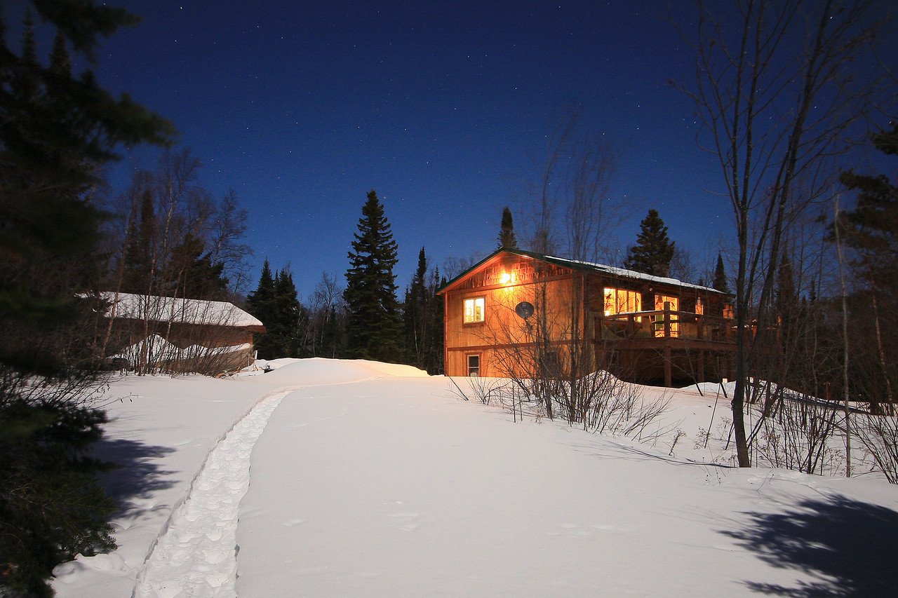 "MOONLIGHT 5321<br /> <br /> ""Northland Nights""<br /> <br /> This is a shot of my house and the snowshoe trail that I have going down to the Lake Superior shoreline, taken during the light of the February full moon."