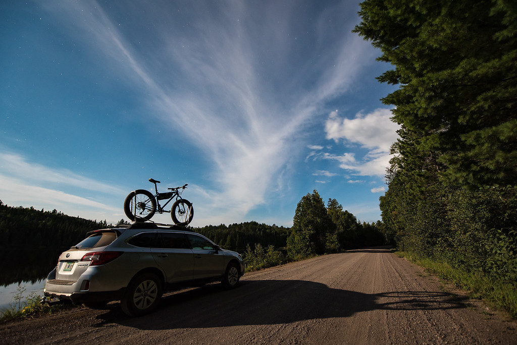 "MOONLIGHT 9574<br /> <br /> ""Having fun in the moonlight on the drive home""<br /> <br /> After spending several hours riding the singletrack mountain bike trails at Britton Peak in Tofte, MN I drove the backroads to get home.  It was a beautiful moonlit night and I stopped along the drive to photograph  my car and bike beneath this beautiful moonlit sky."