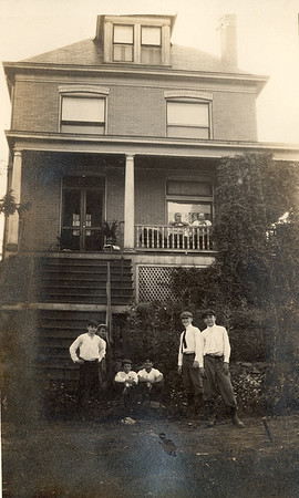 Grandfather Bonini (on porch) with family and friends