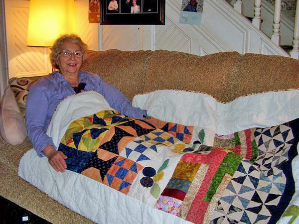 Mary gave this quilt to her sister Kathleen Puhalla in the Spring of 2013. Kathleen displays the quilt in her Romney WV home. Eight people from the Paris TN Quilt Guild (including Mary) participated in the making of the quilt.