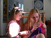 Julia shows Rachael how to knit.