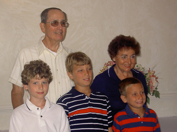 Dick and Joan [Lacey] Tallman with their Grandchildren L >> R Anthony Furr, Josef Helmle, Tyler Helmle. Photo taken June 2006 in Morehead City NC celebrating 50th Wedding Anniversary of Joan and Dick.