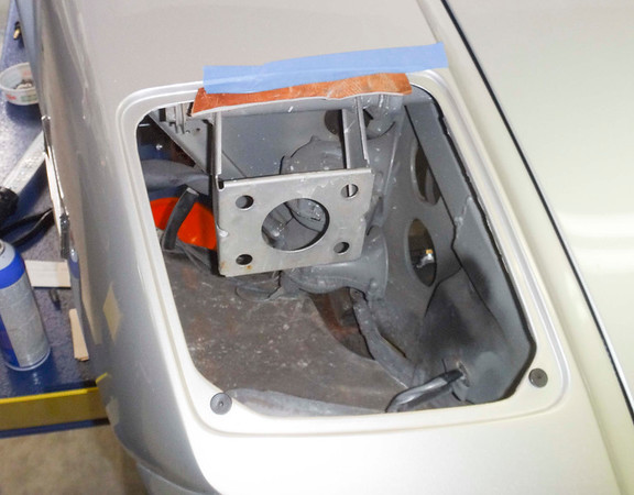 View down into the hole for the right-hand headlight bucket