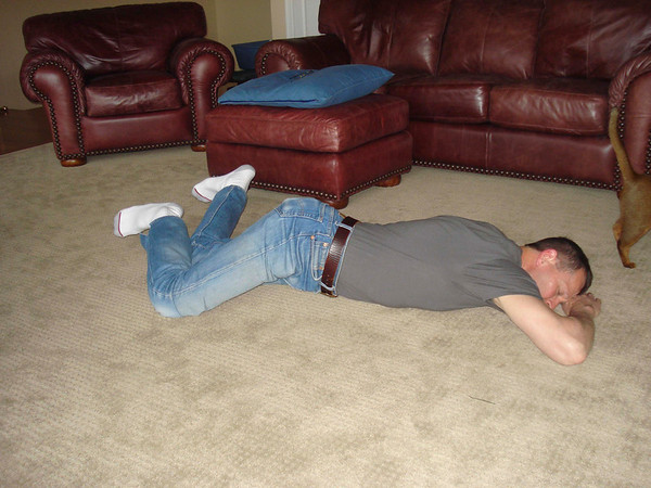Laying on stomach, bend knees and rotate feet to one side.