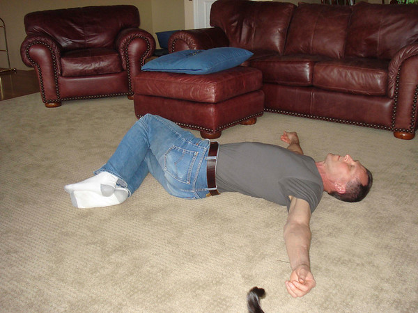 Shoulders flat to floor, knees bent, and roll knees to one side - head to the other side.