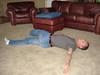 Straighten both legs, pull one as far across as you can while keeping shoulders flat to the floor.