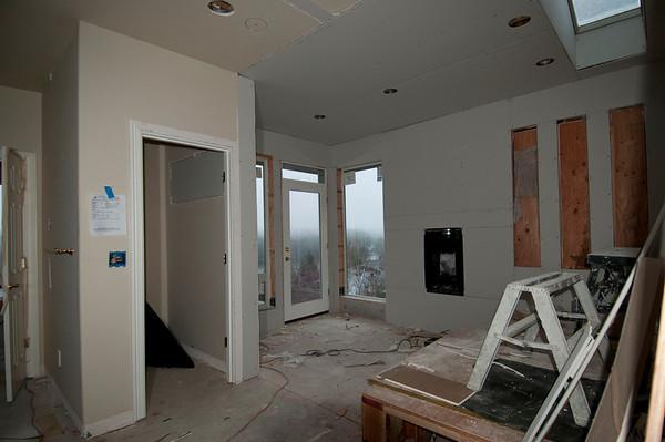 Windows in, fireplace set, sheet-rock up, beginning to look good!