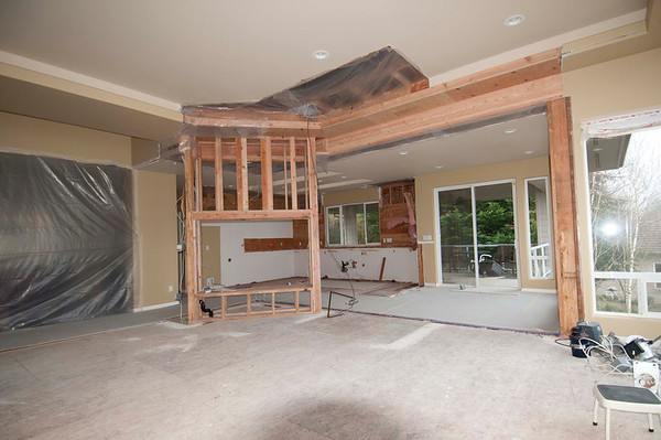 New wall with opening for fireplace framed in.