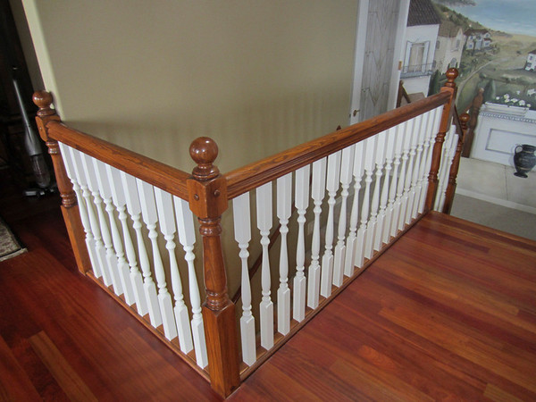 While the stair rail didn't match anything else in the house, it did match the style we see in other homes in the area.  Must have had a sale on these rails 15 years ago!  Fortunatley it went away.