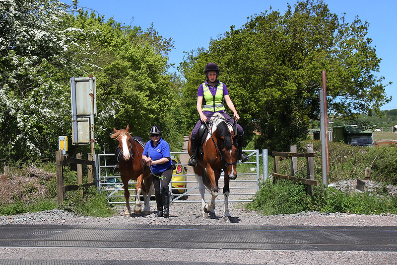 14th May 2018:  When waiting to picture a train at MastersCrossing iin Fairwood it is uncommon to see anyone coming just to use the crossing.  These riders had correctly phoned the Signal Box to check that it was safe to cross.