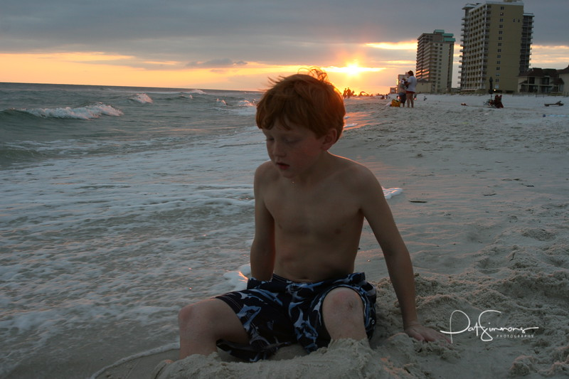 Playing in the sand. Gulf Shores, AL