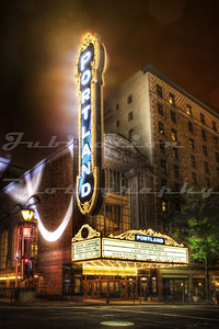 The Arlene Schnitzer Concert Hall, Portland, OR.  Opened as the Portland Publix Theatre in 1928 and soon renamed to the Paramount.  It's sister theater is in Seattle.  The vertical sign is a 30 year old replica made to look like the original.  This theater often appeared on one of my favorite TV shows, Leverage.
