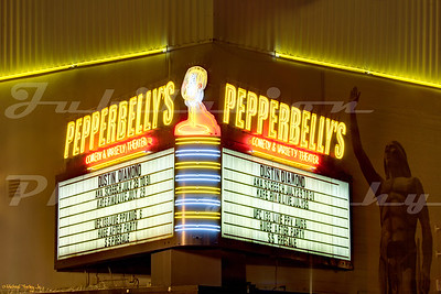 Pepperbelly's Comedy and Variety Theater In Fairfield, CA.  Opened as the Solano Theater in 1941.  The theater burned down in 2013.  Its almost as though the mostly naked Indian knew what was soon to happen, and was waving farewell...