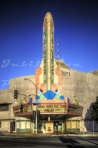 The Crest Theatre, Fresno, CA.  Opened in 1949.  Eventually completely emasculated of all it's glorious neon.  You can at least tell this used to be a magnificent theatre.