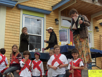 The older kids prepare to perform a traditional Morris stick dance.  Heather Holme on accordian.  photo by James McMahon