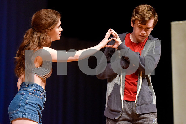 Berri Harris, left, as Judy and Fritz Hager, right, as Christopher during a dress rehearsal of The Curious Incident of the Dog in the Night-Time at Robert E. Lee High School in Tyler, Texas, on Tuesday, March 27, 2018. The students are competing in the area-level of UIL this Saturday. (Chelsea Purgahn/Tyler Morning Telegraph)