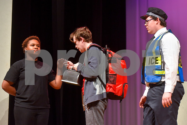 Fritz Hager, center, as Christopher during a dress rehearsal of The Curious Incident of the Dog in the Night-Time at Robert E. Lee High School in Tyler, Texas, on Tuesday, March 27, 2018. The students are competing in the area-level of UIL this Saturday. (Chelsea Purgahn/Tyler Morning Telegraph)