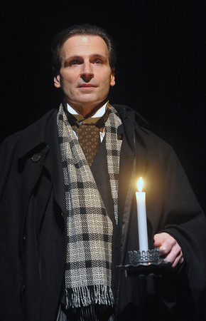 Paul Morella brings the compassionate, intimate and heartwarming tale of A CHRISTMAS CAROL: A GHOST STORY OF CHRISTMAS to life at Olney Theatre Center.  (Photo by Stan Barouh)